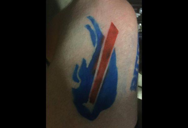 Airbrush tattoo individual sitting