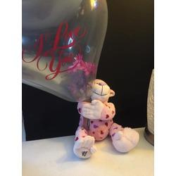 monkey fresh flower stuffed inside of a balloon